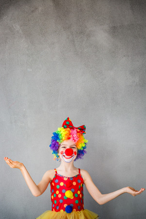 Funny kid clown. Child playing at home. 1 April Fools day concept
