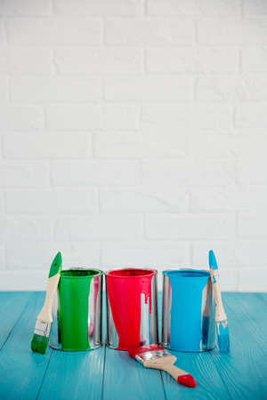 Paint can on wooden table. Spring renovation concept