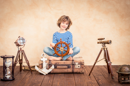 Child pretend to be sailor. Kid having fun at home. Summer vacation and travel concept Imagens