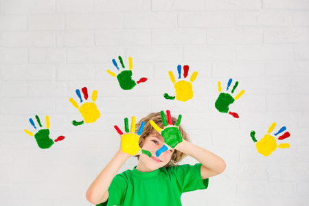 Happy child playing at home. Kid having fun indoor. Spring renovation concept