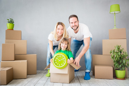 box: Happy family playing into new home. Father, mother and child having fun together. Moving house day and express delivery concept Stock Photo