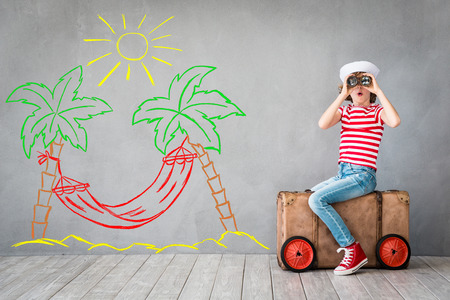 Child pretend to be sailor. Kid having fun at home. Summer vacation and travel concept Standard-Bild