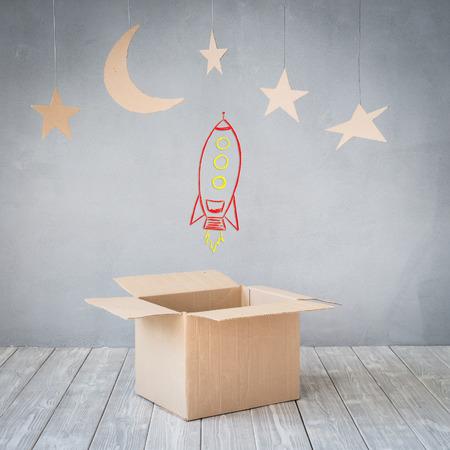 star: Cardboard stars against grey concrete wall background