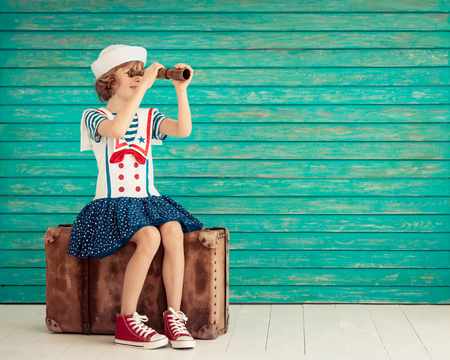 freedom: Child pretend to be sailor. Kid having fun at home. Summer vacation and travel concept Stock Photo