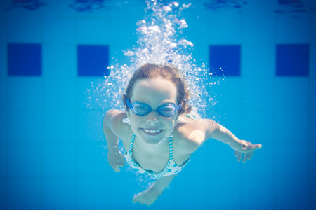 Underwater portrait of child. Kid having fun in swimming pool. Summer vacation concept Stock Photo