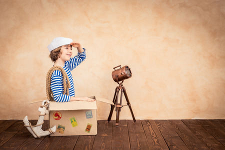 Child pretend to be sailor. Kid having fun at home. Summer vacation and travel concept Stock Photo