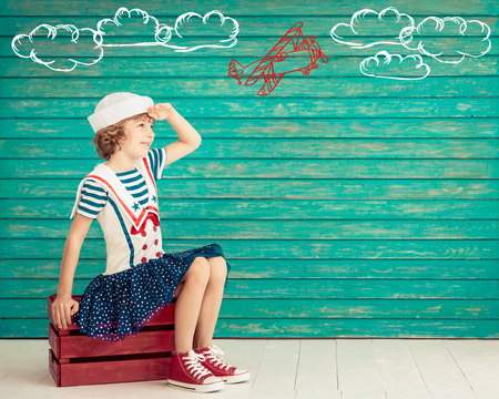 1: Child pretend to be sailor. Kid having fun at home. Summer vacation and travel concept Stock Photo