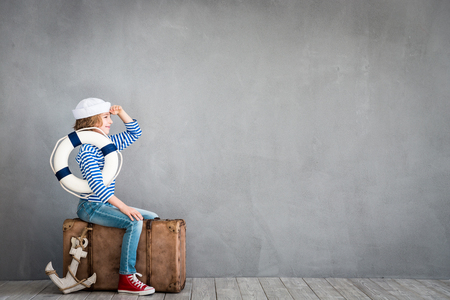 Child pretend to be sailor. Kid having fun at home. Summer vacation and travel concept Archivio Fotografico