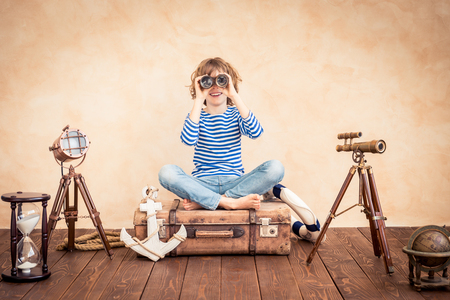 Child pretend to be sailor. Kid having fun at home. Summer vacation and travel concept Stok Fotoğraf