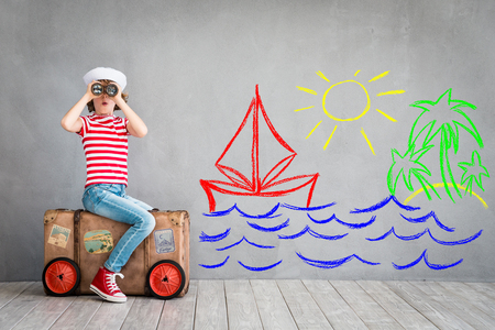 home: Child pretend to be sailor. Kid having fun at home. Summer vacation and travel concept Stock Photo