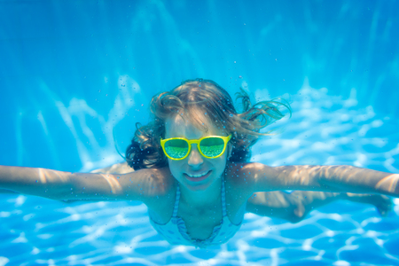 freedom: Underwater portrait of child. Kid having fun in swimming pool. Summer vacation concept Stock Photo