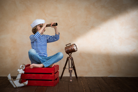 spotlight: Child pretend to be sailor. Kid having fun at home. Summer vacation and travel concept Stock Photo