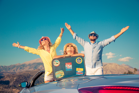 Happy family travel by car. People having fun in the mountains. Father, mother and child on summer vacation. Stock Photo
