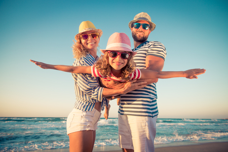 Happy family on the beach. People having fun on summer vacation. Father, mother and child against blue sea and sky background. Holiday travel concept 版權商用圖片 - 78279146