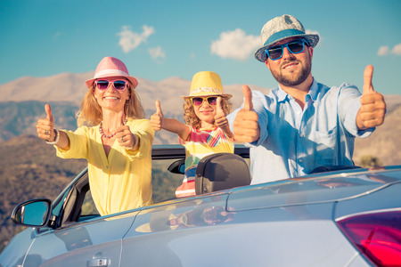 Happy family travel by car. People having fun in the mountains. Father, mother and child on summer vacation. Stockfoto
