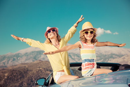 hand: Happy family travel by car. People having fun in the mountains. Mother and child on summer vacation.