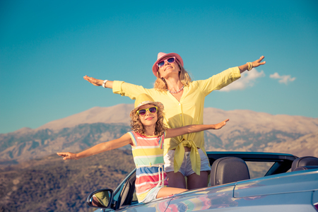 Happy family travel by car. People having fun in the mountains. Mother and child on summer vacation.