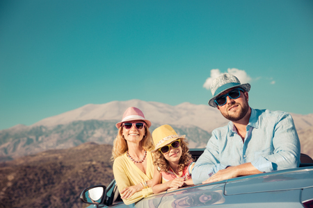 Happy family travel by car. People having fun in the mountains. Father, mother and child on summer vacation. photo