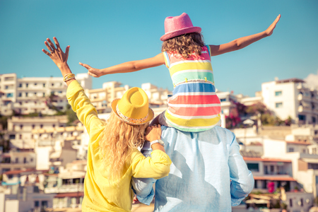 Happy family travelling. People having fun in old european town. Summer holiday and vacation concept photo