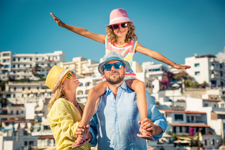 Happy family travelling. People having fun in old european town. Summer holiday and vacation concept