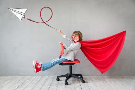 Superhero child. Kid pretend to be businessman. Success, creative and imagination concept 스톡 콘텐츠