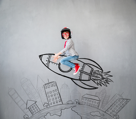 Portrait of young child pretend to be businessman. Kid playing at home. Success, idea, and creative concept. Copy space for your text Stockfoto