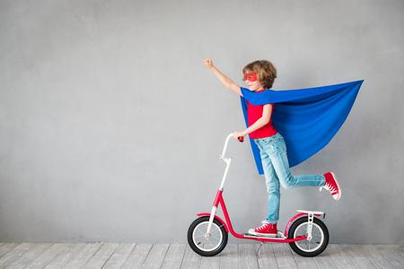 Child pretend to be superhero. Superhero kid. Success, creative and imagination concept photo