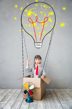 Portrait of young child pretend to be businessman. Kid playing at home. Imagination, idea and creative concept. Copy space for your text Banque d'images