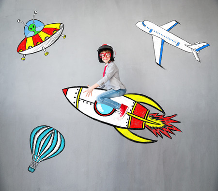 Portrait of young child pretend to be businessman. Kid playing at home. Imagination, idea and creative concept. Copy space for your text Archivio Fotografico