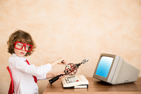 Portrait of young child pretend to be businessman. Kid playing at home. Success, idea, and creative concept. Copy space for your text photo