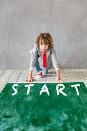 Child pretend to be businessman. Kid playing at home. Education start up concept. Back to school. Copy space for your text