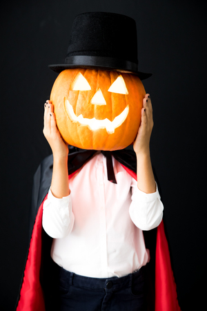 Funny child dressed Halloween costume. Kid painted terrible vampire. Autumn holiday concept Stock Photo