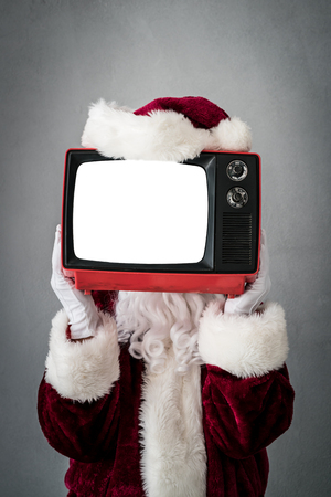 Santa Claus holding retro TV with screen blank. Christmas Xmas holiday concept Stock Photo