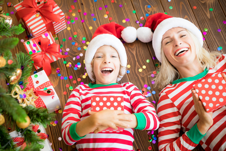 Happy family holding Christmas gift boxes. Xmas holiday concept