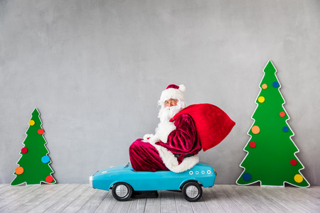 Santa Claus riding car. Christmas Xmas holiday concept Фото со стока - 87916577