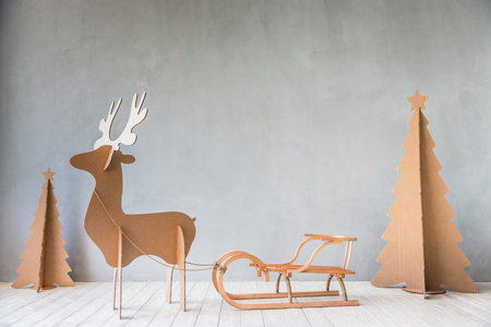 Christmas tree and reindeer. Xmas Winter Holiday Concept