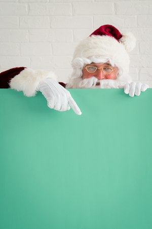Santa Claus holding banner blank. Merry Christmas greeting card. Xmas holiday concept