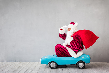 Santa Claus riding car. Christmas Xmas holiday concept Stock fotó - 89220710
