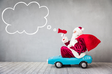 Santa Claus riding car. Christmas Xmas holiday concept