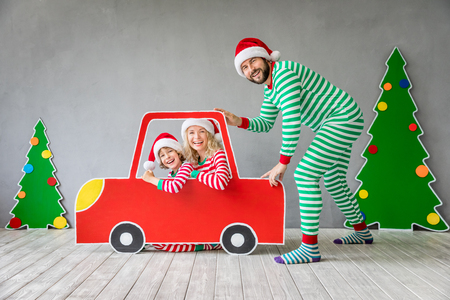 Happy family playing at home. Funny father; mother and child on Christmas eve. Xmas winter holiday concept Stock Photo