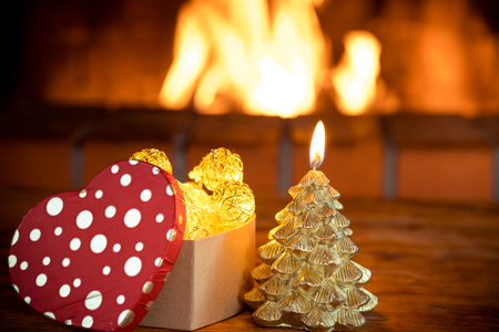Christmas tree decorations near fireplace. Winter holiday Xmas and New Year concept