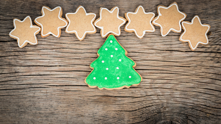 Traditional sweet Christmas cookies on wooden background Banco de Imagens