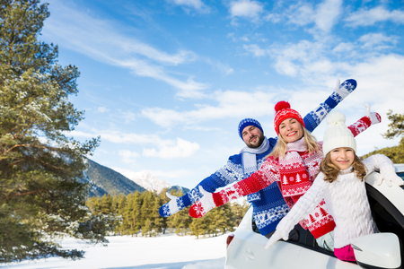 Happy family travel by car. People having fun in the mountains. Father, mother and child on winter vacation. Healthy active lifestyle concept Stock Photo
