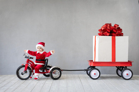 Happy child having fun on Christmas time. Kid playing at home. Christmas holiday concept