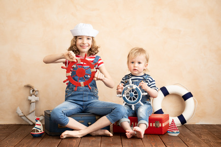 Happy children pretend to be sailor. Funny kids playing at home. Summer vacation and travel concept