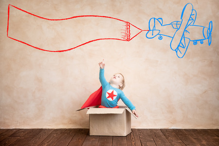 Superhero child. Super hero kid playing at home. Think outside the box concept Stock Photo