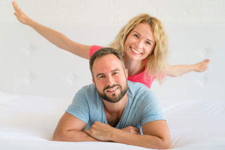 Man and woman at home. Couple having fun together. Family holiday concept. Happy Father's day Stok Fotoğraf - 115344022