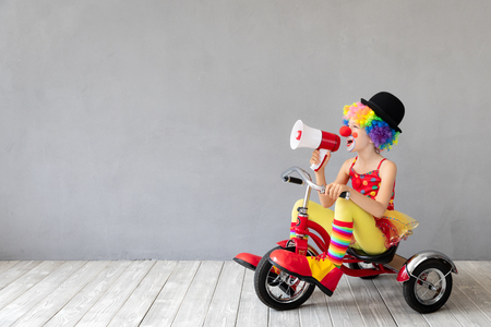 Funny kid clown. Happy child playing at home. 1 April Fool's day concept Imagens - 115343774