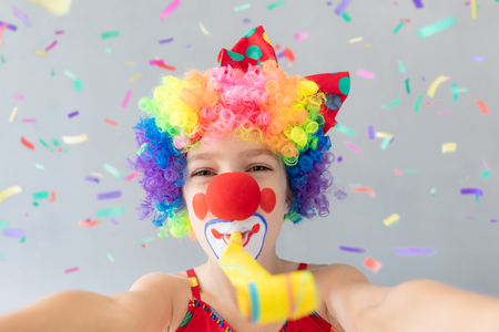 Funny kid clown. Happy child playing at home. 1 April Fools day concept