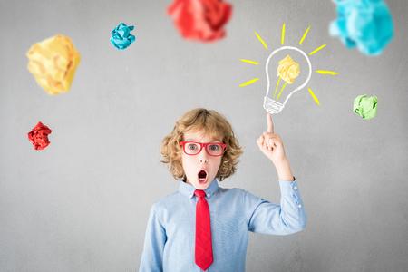 Surprised child pretend to be businessman. Success, creative and idea concept
